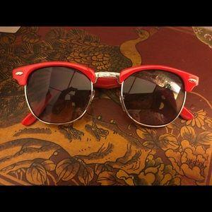 Red wayfarer sunglasses.
